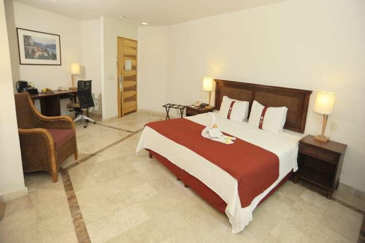 Hotel Gamma Inn Ixtapa Cuartos con Cama King Size, TV Cable. Descubra la atmósfera perfecta para descansar o trabajar en el Hotel Gamma Inn Ixtapa Zihuatanejo
