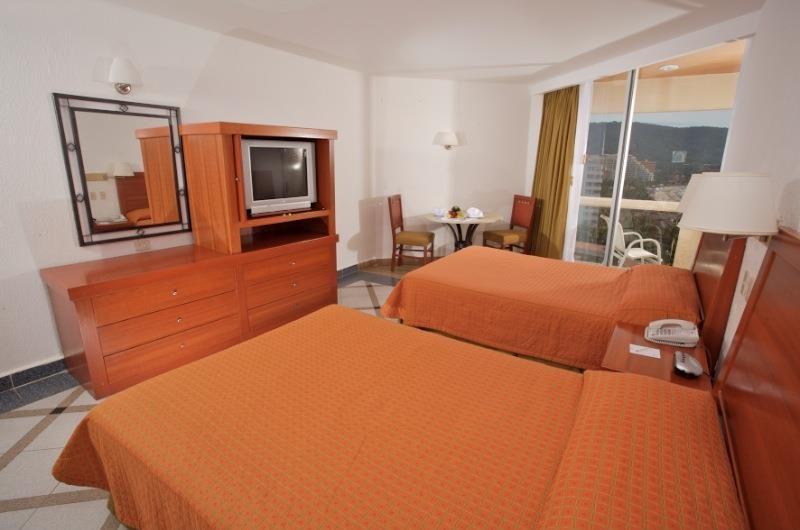 Hotel Park Royal Ixtapa Cuartos. Habitación Estándar con vista al jardín. Nuestras cómodas habitaciones con decoración estilo contemporáneo mexicano son el sitio ideal para que descanses en Ixtapa Zihuatanejo. Camas: 2 matrimoniales o 1 king size